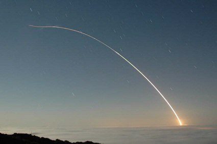 A Minuteman III ICBM heads downrange following launch from Vandenberg AFB