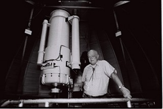 Ray White Jr. stands next to the University of Arizona telescope to be renamed in his honor.