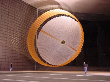 Engineers test a Mars parachute inside a wind tunnel at NASA Ames Research Center
