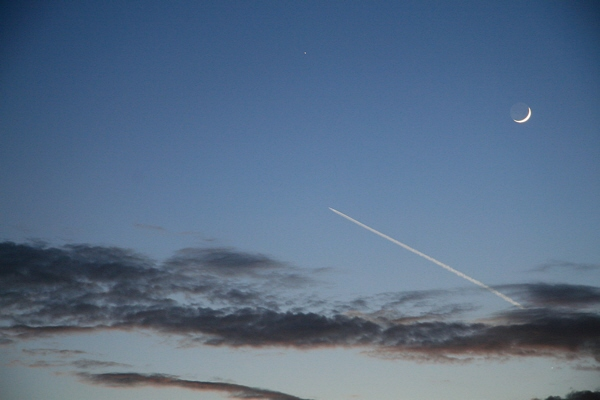 Delta IV rocket trail passes below the Moon and Venus